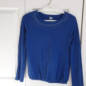 A blue shirt with rhine stones